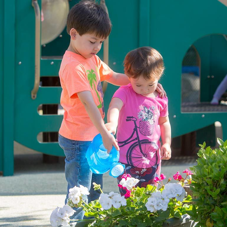 Bright Horizons Preschool Students watering the flowers