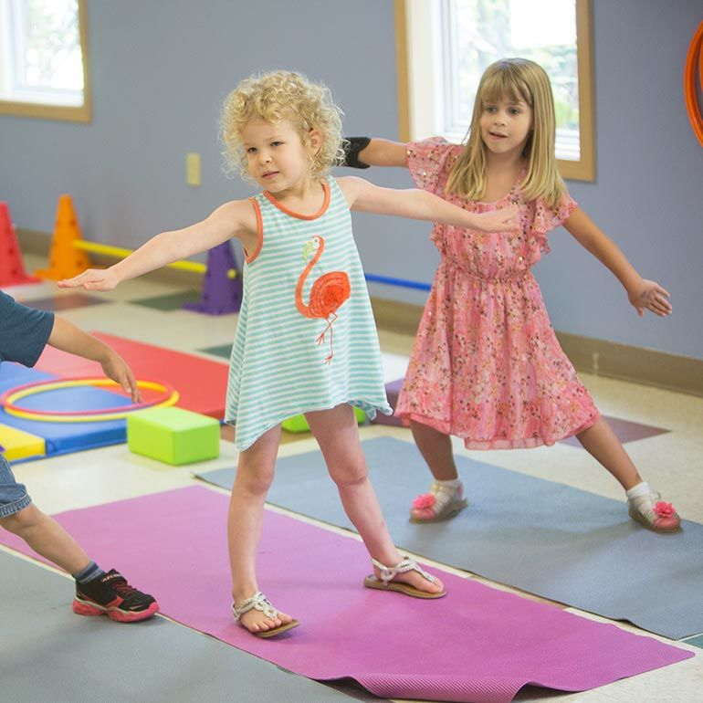Bright Horizons Preschool Students stretching and yoga