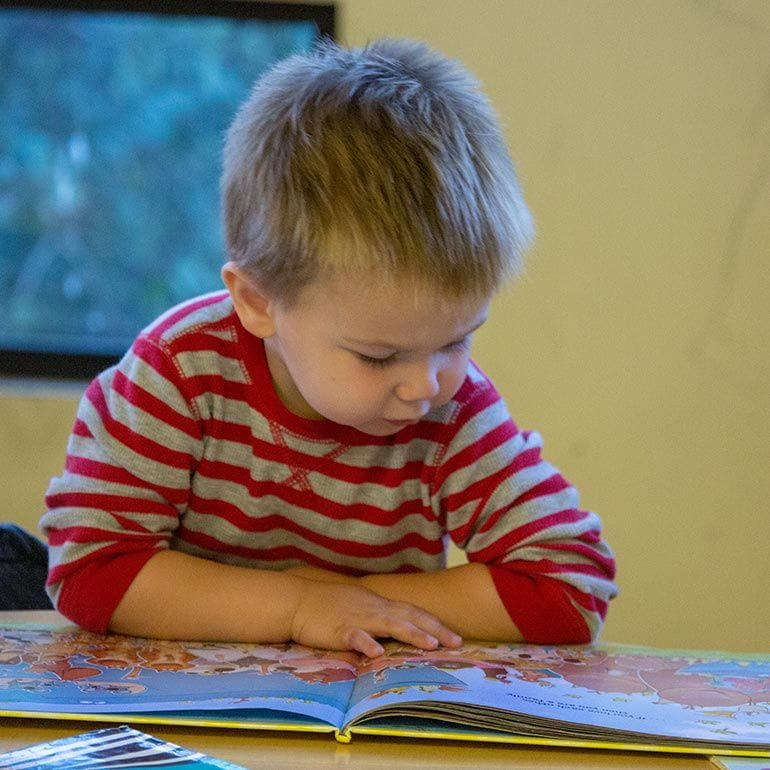 Bright Horizons Toddler Student reading a book
