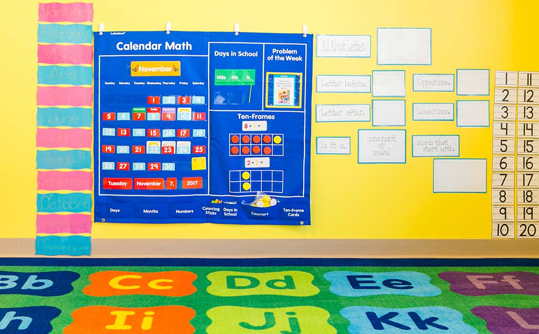 Math wall and alphabet carpet in a preschool